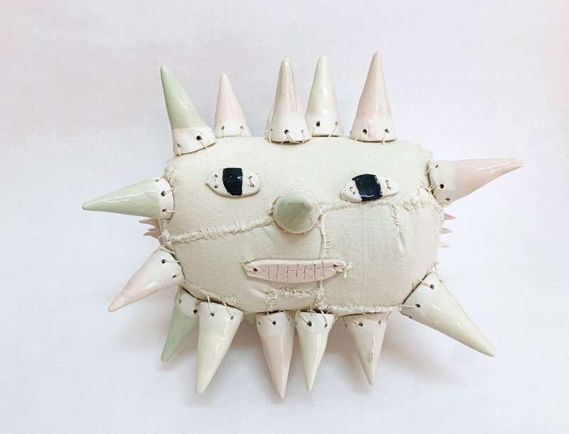 Lusesita,-Star-with-face,-2021,-handpainted-ceramic-and-fabrics,-cm